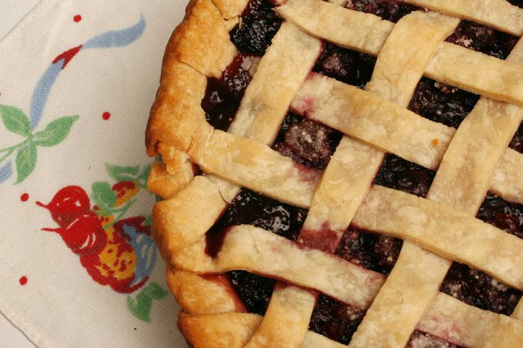 Combine frozen and dried cherries,  sugar,  tapioca and almond extract.  Cover the pie with the remaining pastry;  trim the excess,  crimp the edges and slash with a knife in a few places to let steam escape.  If you'd like to try a lattice crust - very pretty with the bright cherries peeking out - and you need some guidance,  you can find clear instructions with lots of images at the Fine Cooking magazine Web site: www.taunton.com/finecooking/thanksgiving/fb00175_rec01.asp.
