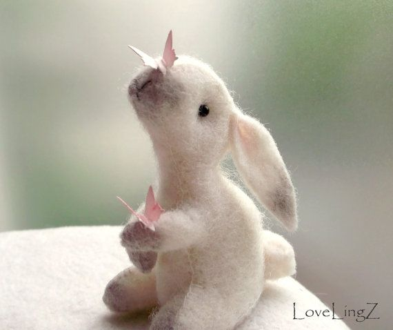 Hey, I found this really awesome Etsy listing at https://www.etsy.com/listing/185959165/felt-rabbit-with-butterflies-handmade