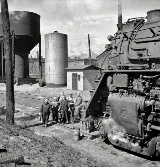 """May 1943. Clinton, Iowa. """"Women wipers of the Chicago & North Western Railroad going out to work on an engine at the roundhouse."""" #train"""