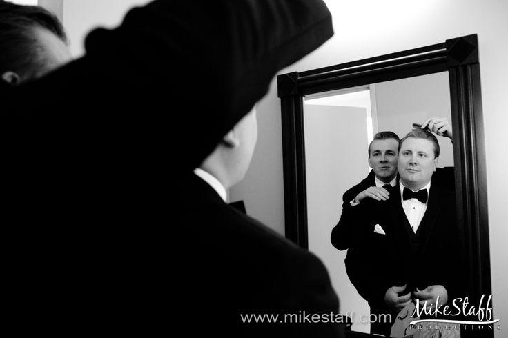 Groomsmen helps groom with his hair #Michiganwedding #Chicagowedding #MikeStaffProductions #wedding #reception #weddingphotography #weddingdj #weddingvideography #wedding #photos #wedding #pictures #ideas #planning #DJ #photography #pre-ceremony #groom
