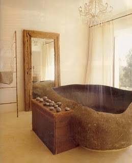 Bath tub carved out of stone.