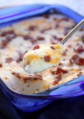 Loaded Mashed Potato Casserole  Source: slightly adapted from Wendy and Gooseberry Patch    5 1/2 cups mashed potatoes (around 6-7 large baking potatoes)  1/2 cup milk  1 (8 ounce) package cream cheese, softened  1 cup (8 ounces) sour cream  2 teaspoons dried parsley  1 teaspoon garlic salt  1/4 teaspoon ground nutmeg  1 cup shredded cheddar cheese  8 slices bacon crispy cooked and crumbled