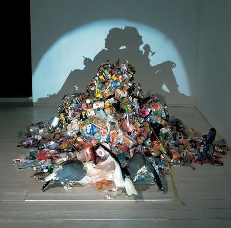 Tim Noble and Sue Webster put together amazing piles of trash that project eerily fluid and intricate silhouettes upon the wall.
