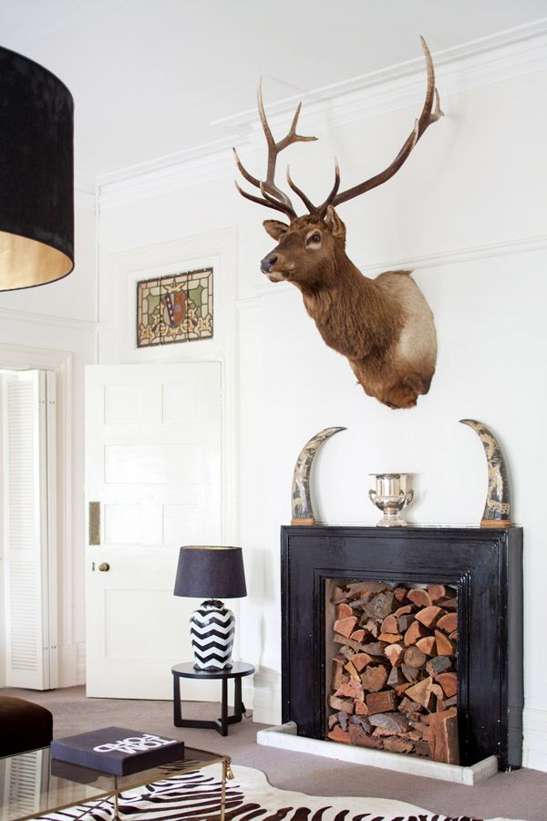 Love the blocked in timber fire place, what a clever way to add interest & texture to a space!