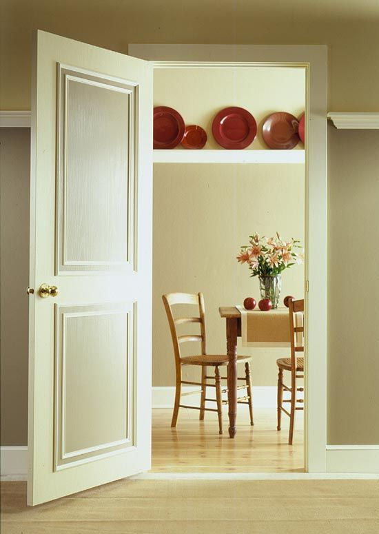 DIY:   Upgrade a Door with Molding - if your interior doors are blah, give them a facelift with some inexpensive moulding & paint.