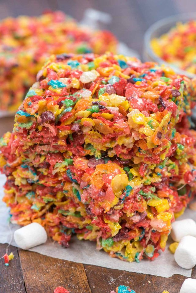 Fruity Pebble Krispie Treats are the best kind of marshmallow cereal treat! Made with fruity pebbles and lots of marshmallows this recipe is gooey and sweet and the perfect rainbow treat!