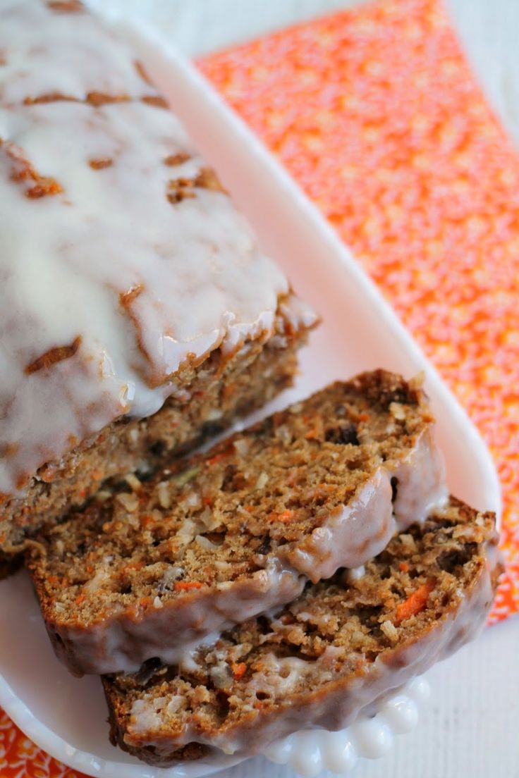 This moist Healthy Carrot Cake Banana Bread with it's vanilla yogurt glaze only tastes like a decadent treat
