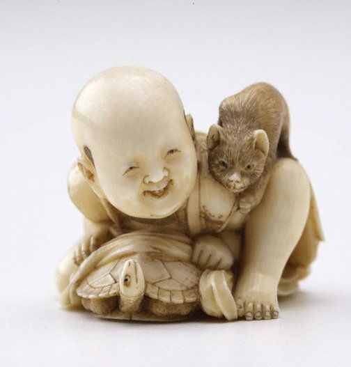 An image of Netsuke in the form of a child with a tortoise and a cat by SEIKO