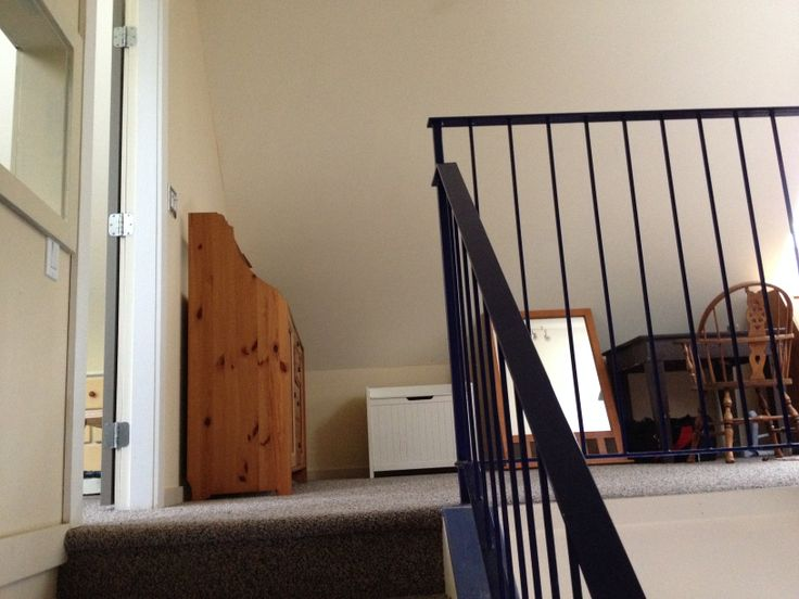 Stairs leading to loft area.