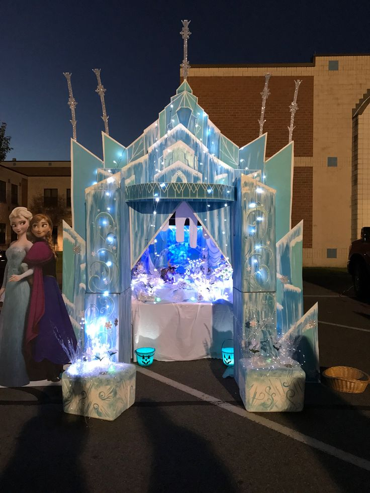 DIY Elsa's castle from Frozen . Trunk or Treat . Great prop for a Photo booth. I made this out of cardboard boxes . I used acrylic paint in various shades of blue, I also melted water bottles to use for the icicles , I went to the Dollar Tree and got various snow flakes and pumpkins that I painted to match the Frozen theme. The front boxes are styrofoam coolers . Great for FROZEN Birthday Party decorations....