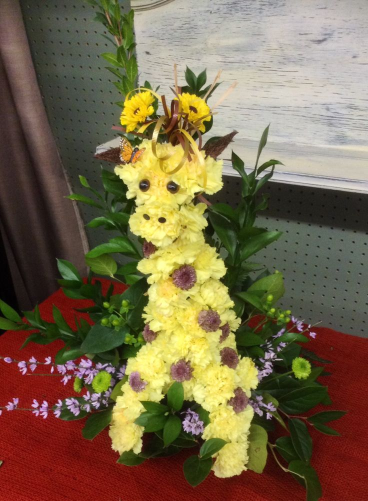 Giraffe made out of carnations and button mums.