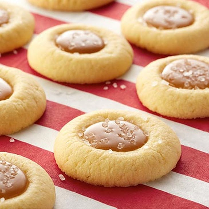 Salted Caramel Thumbprint Cookies Recipe Desserts with Land O Lakes Unsalted Butter, egg yolks, all-purpose flour, firmly packed brown sugar, Land O Lakes Heavy Whipping Cream, sea salt, sugar, vanilla, Land O Lakes Unsalted Butter