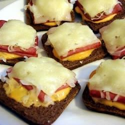 Mini Reuben Sandwiches are quickly made on cocktail rye and broiled for an open-faced hot appetizer that is sure to please!