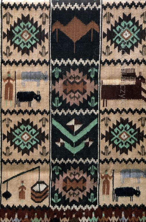 [ROMANIA.MARAMURES 23.760] 'Rural carpet.'  Woolen carpets decorated with traditional rural themes are a successful village craft in Botiza. Photo Mick Palarczyk.