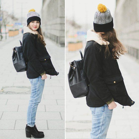 Shop this look on Lookastic: https://lookastic.com/women/looks/shearling-jacket-jeans-lace-up-ankle-boots-backpack-beanie/6681 — Black and White Print Beanie — Black Suede Lace-up Ankle Boots — Light Blue Jeans — Black Leather Backpack — Black and White Shearling Jacket