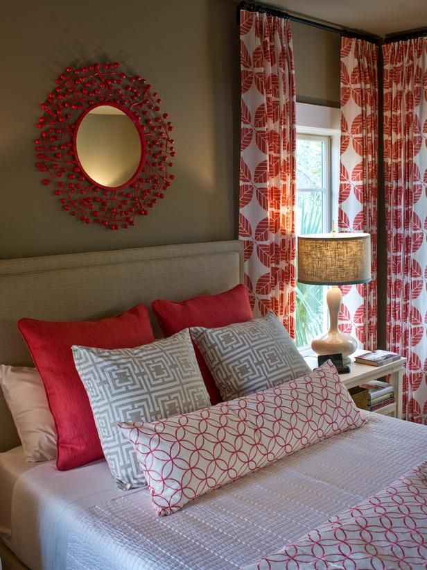 Welcoming guest bedroom.. white and red patterned curtains and bedding. Love the ceiling height curtains