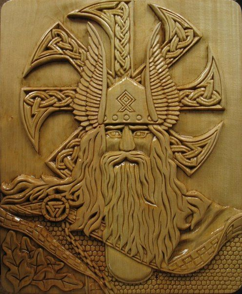 Odin, still with two eyes. Must be a carving from his time BEFORE the well :)