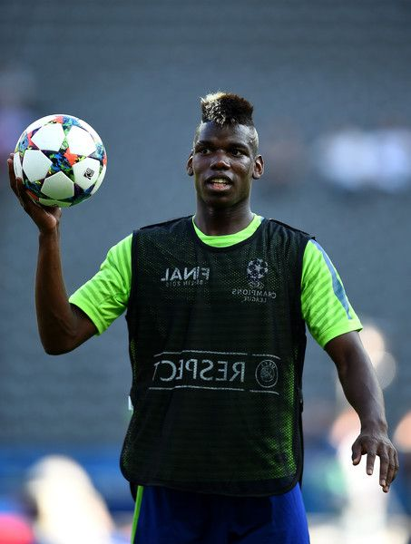 Paul Pogba of Juventus gathers the ball during a Juventus training session on the eve of the UEFA Champions League Final match against FC Barcelona at Olympiastadion on June 5, 2015 in Berlin, Germany.