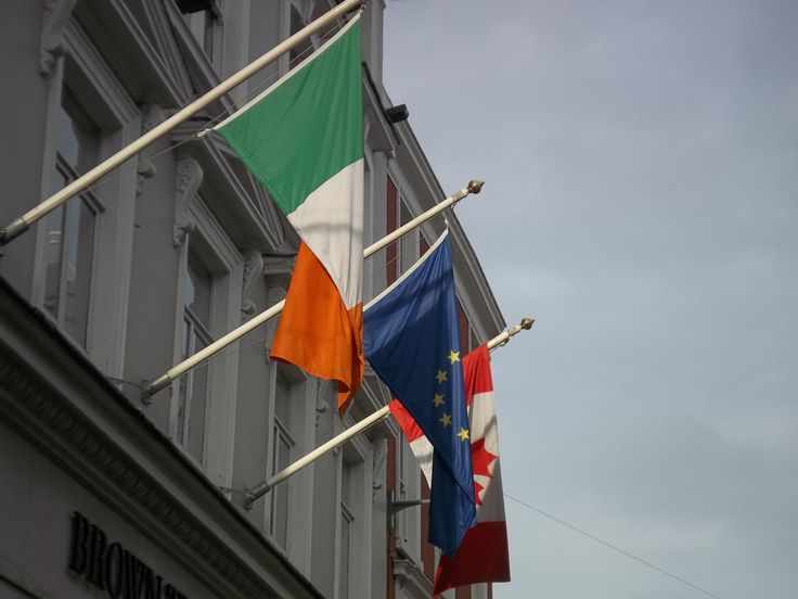 Flags hanging about a building. Possibly Grafton Street.