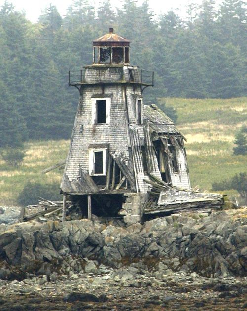 The Grand Harbor Lighthouse on Fish Fluke Point, Ross Island, Canada was built in 1879, a square wooden tower 32-feet tall with the Keeper's dwelling attached.