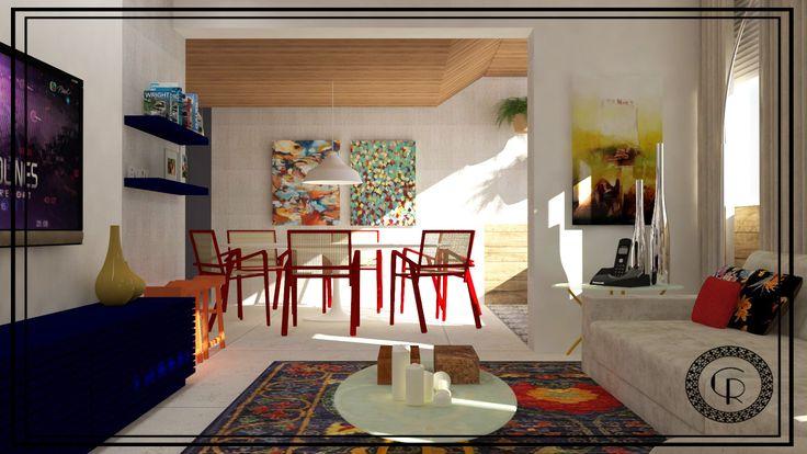 Na sala de jantar, o teto revestido em madeira já existia. A mesa branca com cadeiras vermelhas servem com base para os quadros coloridos e destacam ainda mais o clima descontraído dos moradores.