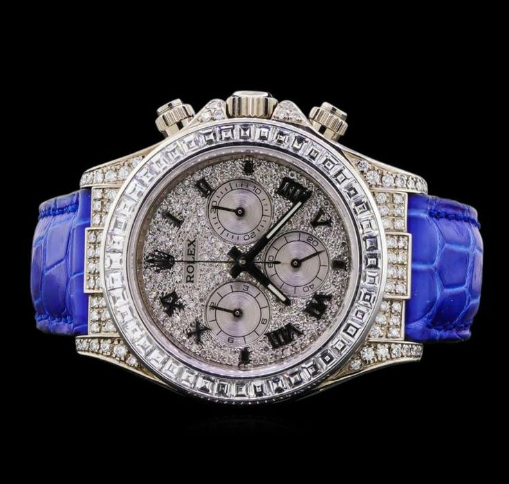 FOR A LIMITED TIME - Ends On 2017-10-01 20:00 (GMT) - Rolex Daytona 18KT White Gold Watch One Rolex Daytona watch featuring: Case: round, 47mm x 43mm 18KT white gold, set with diamonds. Dial: Diamond encrusted white gold with Roman numerals. Bezel: 18KT white gold with diamonds. Movement: Automatic. Crystal: Sapphire. Bracelet: Blue leather with 18KT white gold deployment buckle. Condition: minor scratches on case and minor wear on bracelet, but otherwise in excellent condi