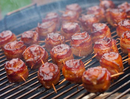 Moink balls.  Smoked meatballs, wrapped in bacon and brushed with some bbq sauce!  A perfect Memorial Day #cookout appetizer.