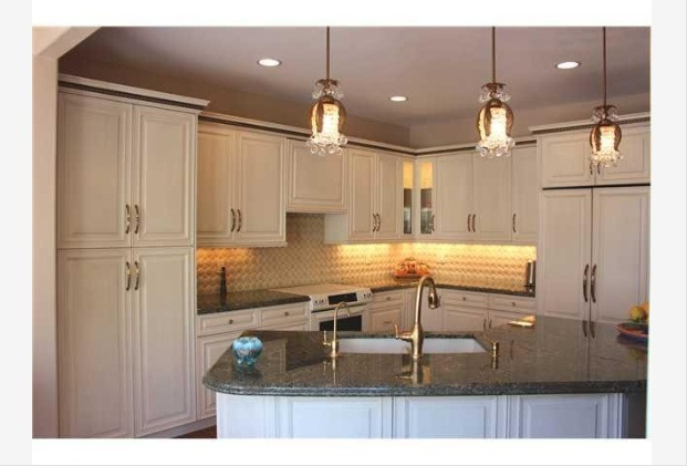 White Kitchen With Angled Island And Pendant Lights, Nice Finishes