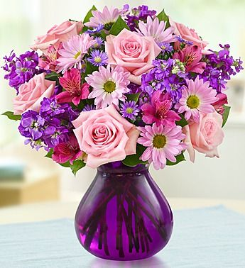 Lavender Dreams™- roses, daisy poms, alstroemeria, stock, monte casino and salal created in honor of Women's Week $44.99- $64.99