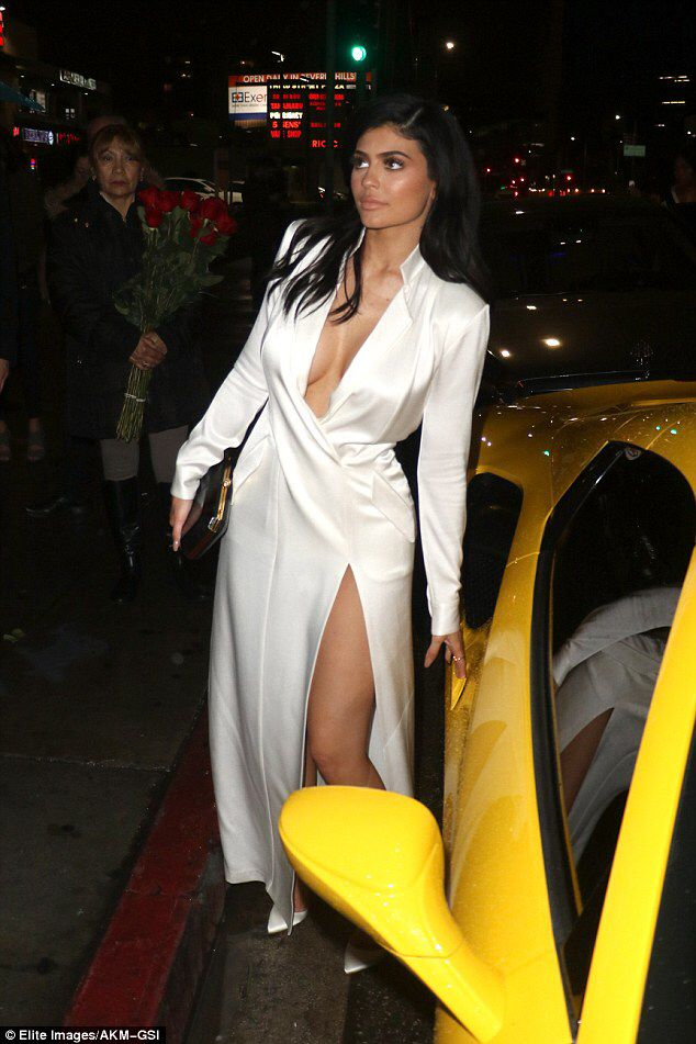 Kylie Jenner goes braless in low-cut silk dress on date with Tyga #dailymail