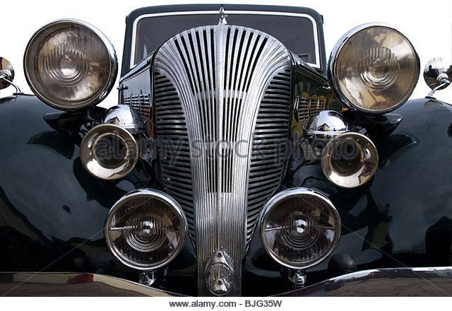 a-vintage-black-car-with-lights-and-chrome-horns-bjg35w.jpg (640×440)