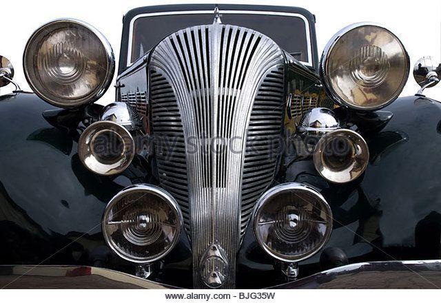 a-vintage-black-car-with-lights-and-chrome-horns-bjg35w.jpg (640×440)