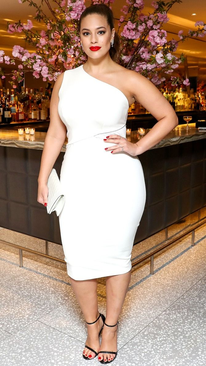 Ashley Graham in a one-shoulder white dress