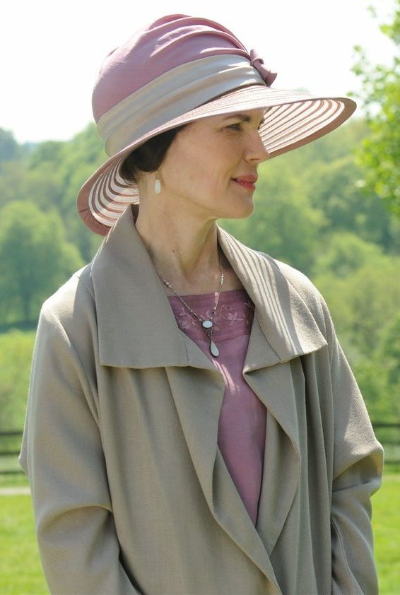 Cora, Countess of Grantham, wearing opal drop earrings and Edwardian filigree and opal pendant necklace.
