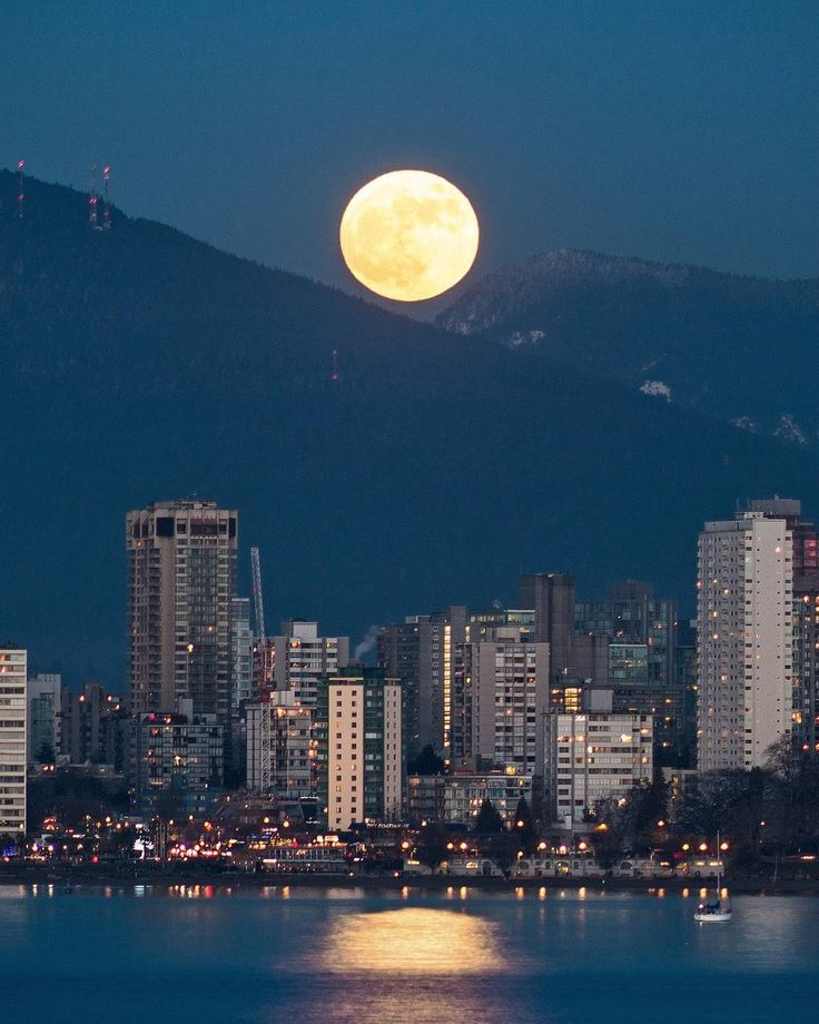 Supermoon 2018  . Tonight's Full Wolf Moon rises over the West End of Vancouver and reflects off of English Bay. If you look close you can see the historic English Bay Bathhouse near the corner of Denman and Davie Street. The'Old Moon' first appeared between @MtSeymour & Coquitlam Mountain and travelled across the Vancouver skyline. Captured at 'Blue Hour' from Kitsilano in Vancouver British Columbia Canada  January 1 2018  .  HAPPY NEW YEAR EVERYONE  . 2017 was a very very busy year for me…