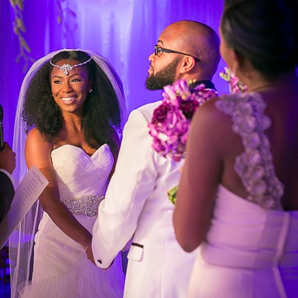 Natural Hair just rocks with the bejeweled type veil! She looks good!