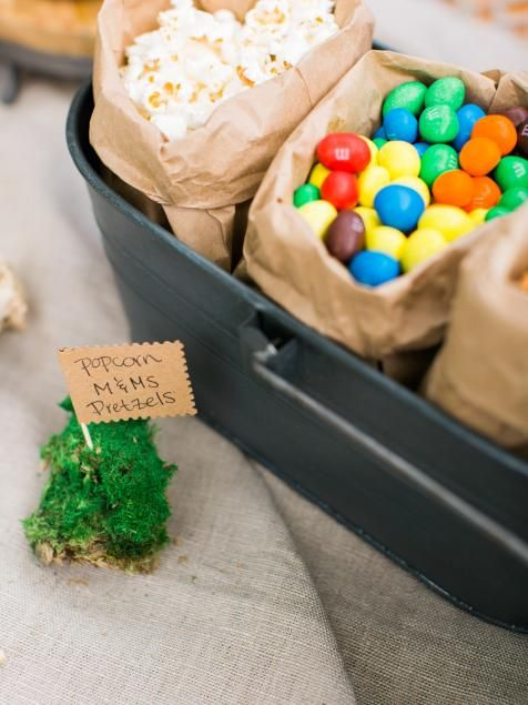 Serve your sweet and savory snacks in a rustic bucket packed with brown paper bags filled with favorites like popcorn, pretzels and chocolate candies. When the party heads into the stadium, guests can each grab a brown bag of their favorite snack to enjoy while watching the game.