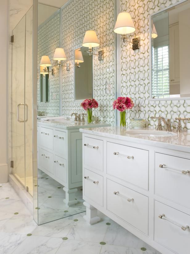 Mirrored-side shower stall, love the wallpaper, so fresh, really pretty bathroom