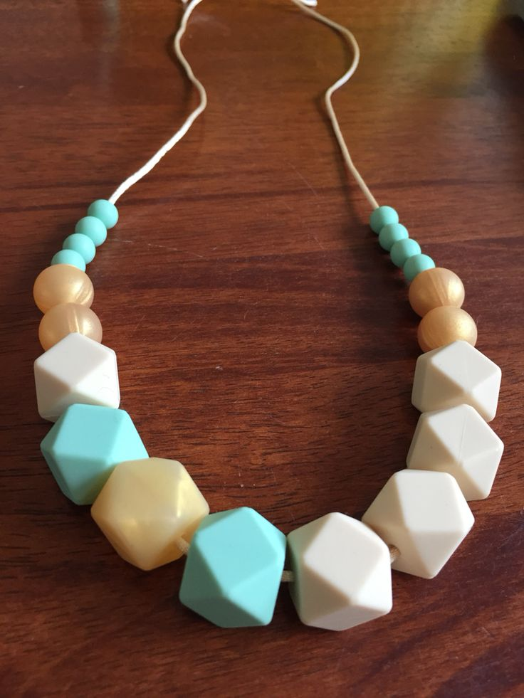 Silicone Teething Necklace- Fussy Little Fox Hexagon Teething Necklace in vanilla, mint and honeycomb on vanilla nylon cord with gold safety catch. $27 + Free Shipping within Australia. Visit Fussy Little Fox on Facebook or email fussylittlefox@gmail.com to order! #fussylittlefox #bpafree #fdaapproved #nontoxic #siliconeteethingnecklace #teething #soregums #baby #dribble #mum #fashion #necklace #chew #oralsensory #sensorychew #fussy #fussybaby #handmade #handmadewithlove
