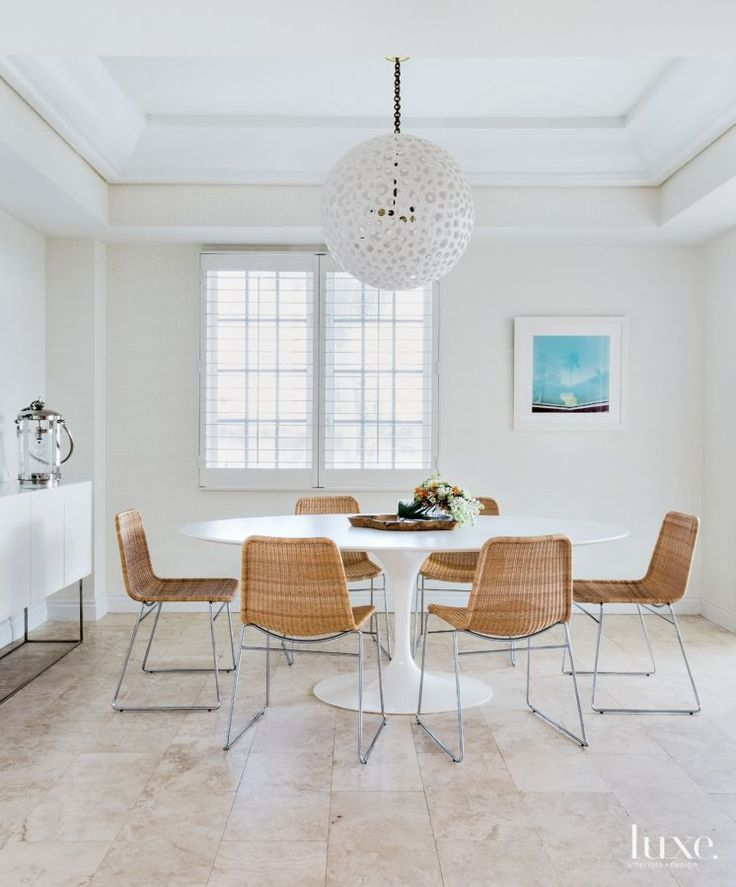 From Luxe Interiors + Design · An Oly Fixture Adds A Sculptural Element To  This Breakfast Area With A Saarinen Table From