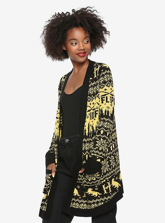 b9873ffb0e03 Be cozy with house pride for Hufflepuff with this long knitted cardigan.  Featuring a pattern made up of broomsticks, a golden snitch, the Hogwarts  skyline ...