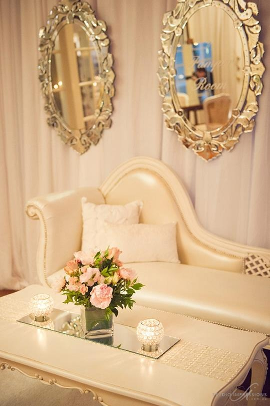 A beautifully arranged Baroque Chaise Lounge with Victorian Mirrors and soft pink centerpiece #furniturehire #furniture #brisbane #weddings #events    http://www.epicempire.com.au/baroque-chaise/