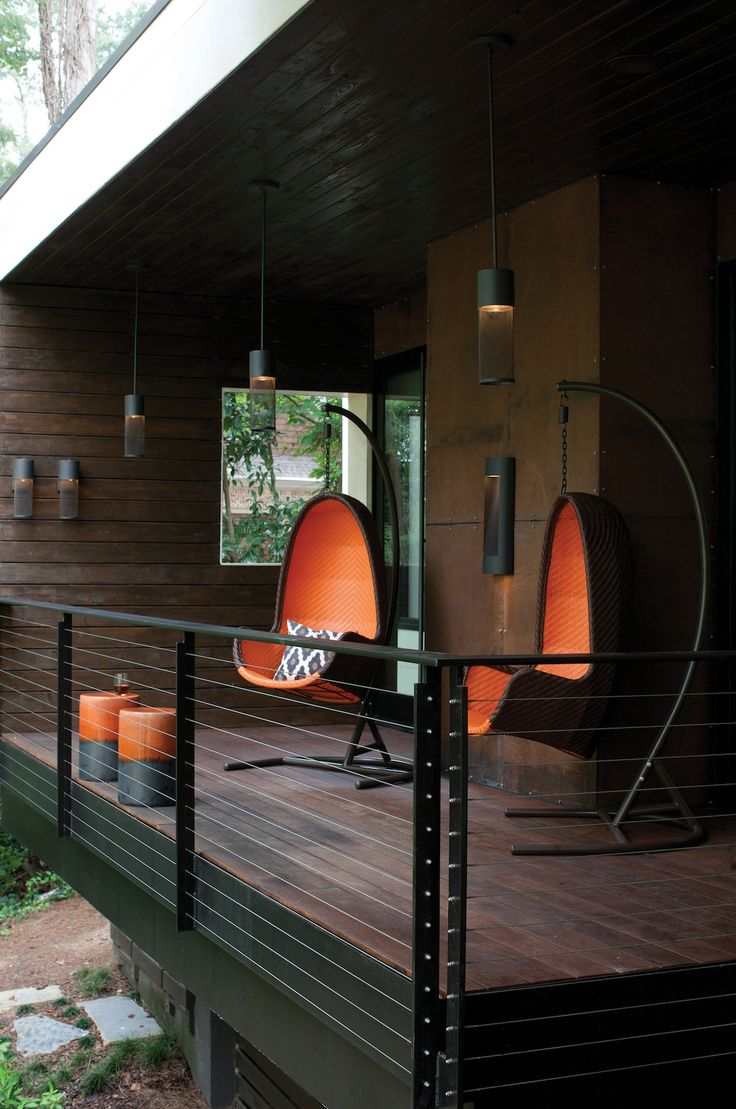 The wire cylinder shades on the Aria LED Outdoor Wall Lights and matching Aria LED Outdoor Pendant Lights pull from the industrial elements of this modern back porch. http://www.ylighting.com/blog/hinkley-outdoor-landscape-lighting/