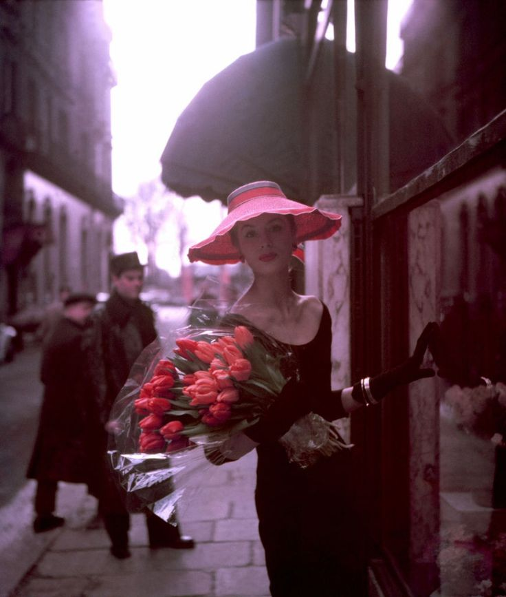 Suzy Parker. With Tulips. Paris as background. Through the lens of Georges Dambier. '53.