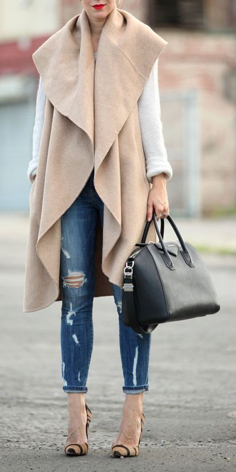 Give some drama to a simple look with a draped sleeveless coat. | Click to see more on ShopStyle.:
