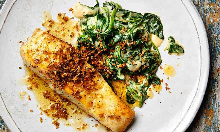 Yotam Ottolenghi's halibut with spinach bechamel and rye crumbs.
