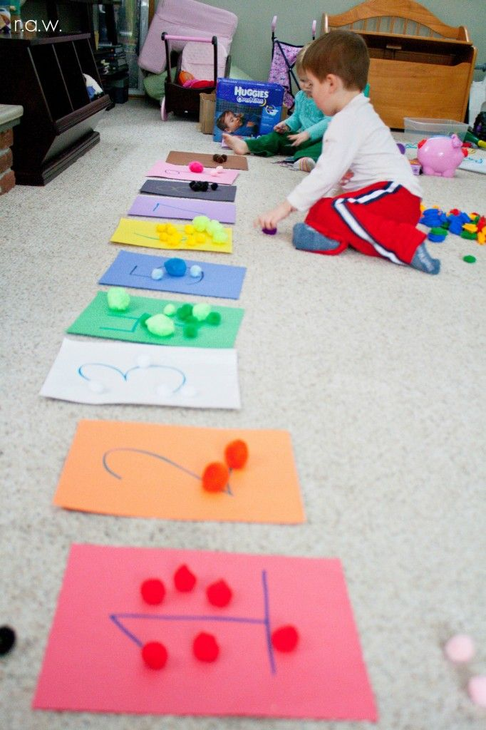 Learning by counting with numbers and materials. **This could also be used as a sorting activity, color matching, etc