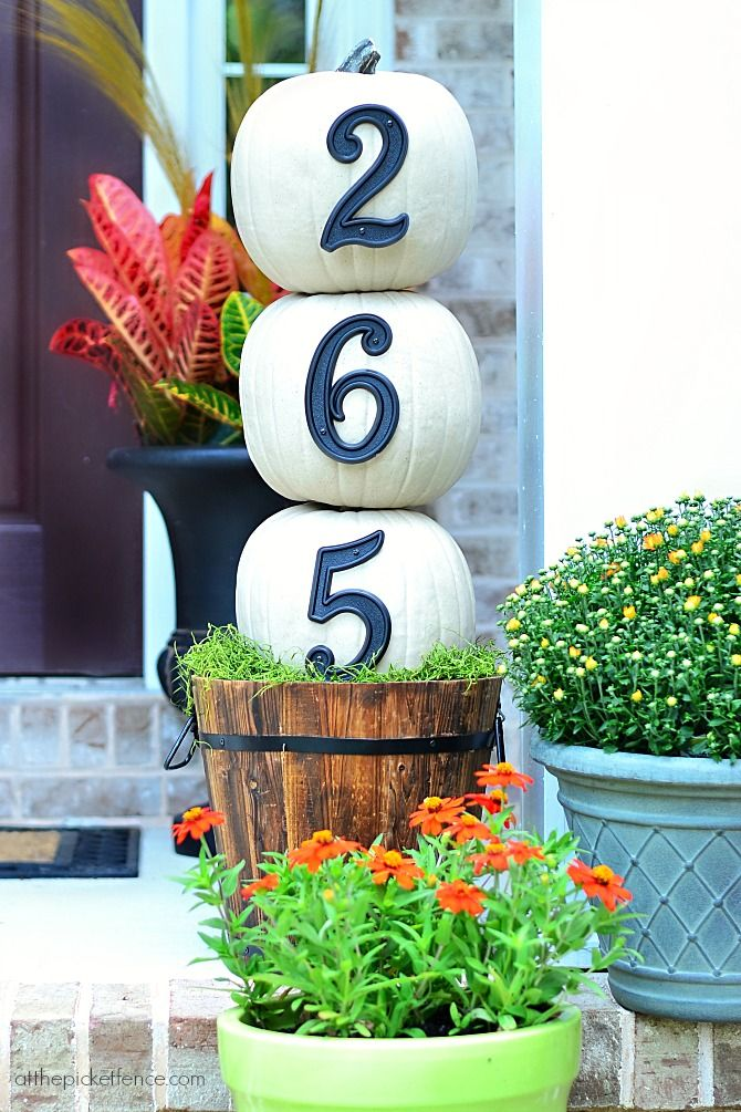 House Numbers Pumpkin Topiary. An easy fall front porch project that anyone can do! @At The Picket Fence