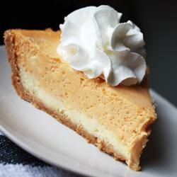"Double Layer Pumpkin Cheesecake Recipe ""A great alternative to pumpkin pie, especially for those cheesecake fans out there. Serve topped with whipped cream."""