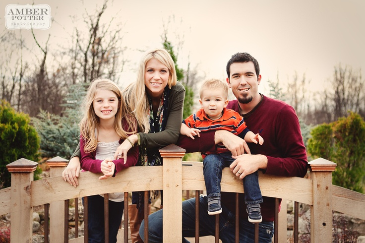 http://www.amberpotterphotography.com - beautiful family photo on a bridge, I really like the processing, too